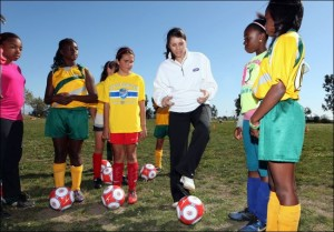 Mia Hamm working with young female soccer players through her foundation